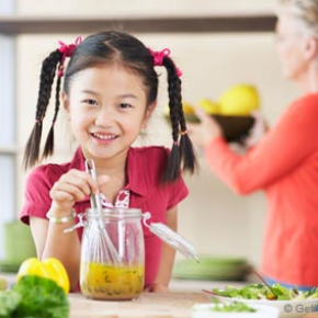 Girl Healthy Cooking in Kitchen