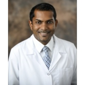 Dr. Mitchell Machado, MD
