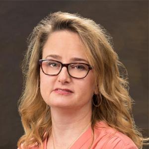 Dr. Leslie K. Tomek, MD