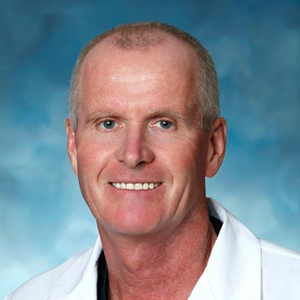 Dr. Caswell J. Rumball, MD