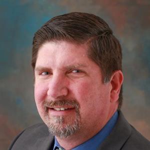 Dr. Waymon E. Lewis, DPM