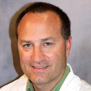 Dr. Bruce W. Young, MD