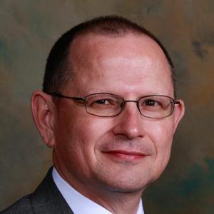Dr. Carlos E. Maas, MD