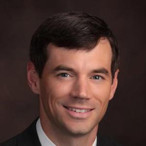 Dr. Wade B. May, MD