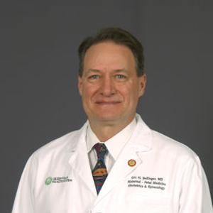 Dr. Eric H. Dellinger, MD