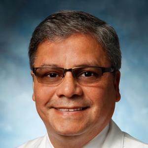 Dr. Carlos A. Corrales, MD