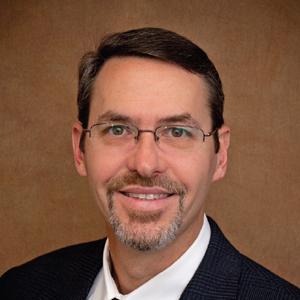 Dr. Carlos A. Guerra, MD