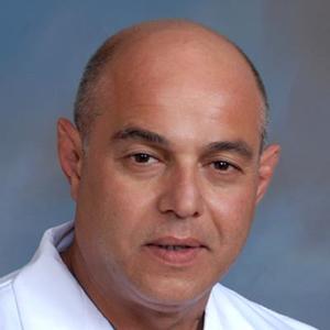 Dr. Carlos M. Guida, MD