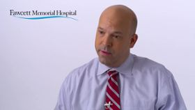 What happens during lumbar spinal fusion surgery?