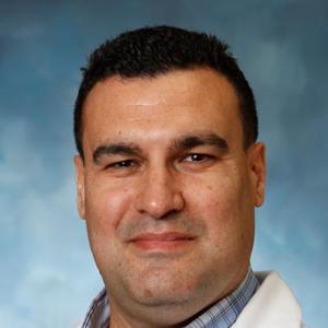 Dr. Carlos E. Ballestas, MD