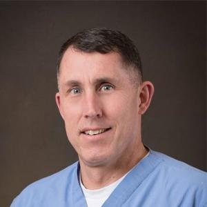 Dr. Chris E. Minette, MD
