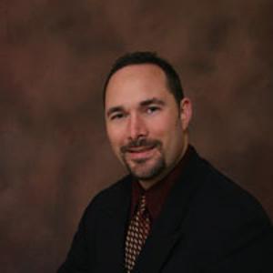 Dr. Morris E. Guthrie, MD