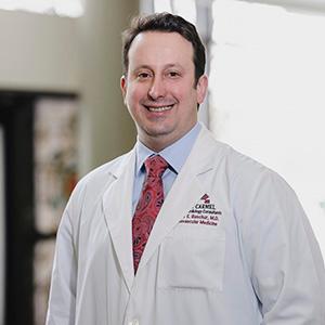 Dr. Michael E. Buschur, MD
