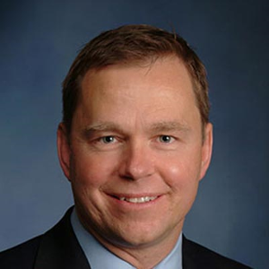 Dr. Richard E. Manos, MD