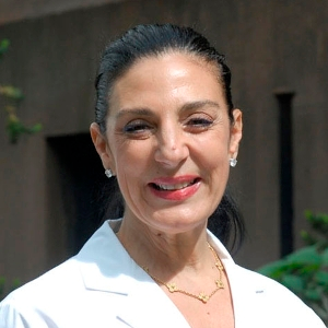 Dr. Laura E. Corio, MD