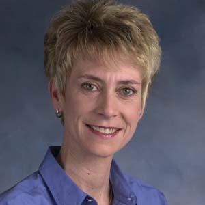 Dr. Paula M. Adam-Burchill, MD
