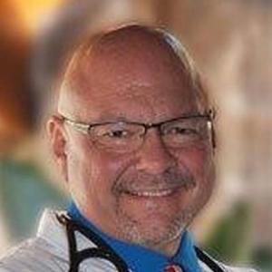 Dr. E T. Arne, DO