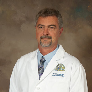 Dr. Kevin W. Holcombe, MD