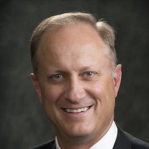 Dr. Gordon E. Harmston, MD