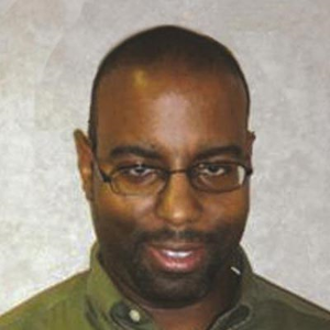 Dr. Aaron L. Cooks, MD