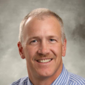 Dr. Clint E. Behrend, MD