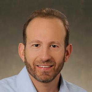 Dr. Craig M. Kornbluth, MD