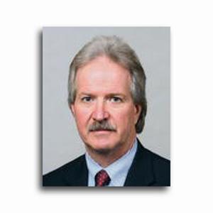 Dr. Mark E. Elles, MD