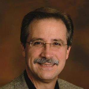 Dr. James E. Delmore, MD