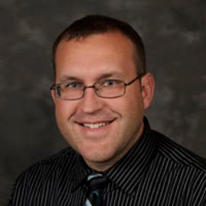 Dr. Justin E. Grill, DO