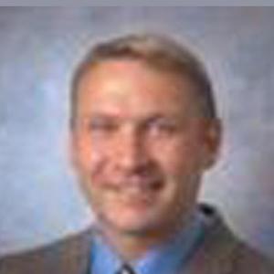 Dr. Christopher M. Godell, MD