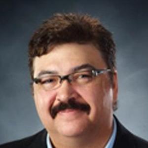 Dr. Gilbert D. Veasey, MD