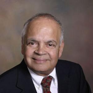 Dr. Thirupaimaruth K. Raman, MD
