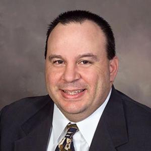 Dr. Greg J. Den Haese, MD