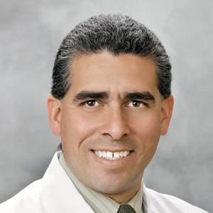 Dr. Carlos E. Rivera-Tavarez, MD