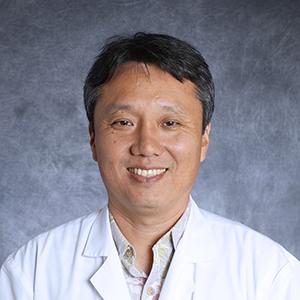 Dr. David J. Tamura, MD