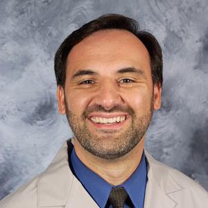 Dr. John M. Revis, MD